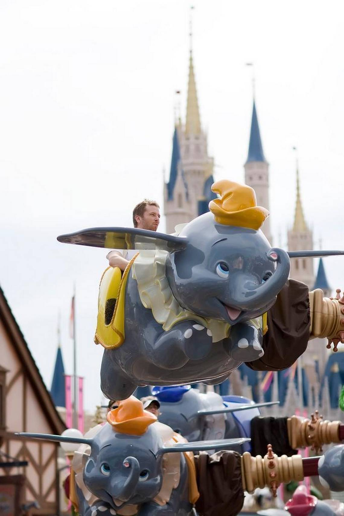 Guests ride on the Dumbo the Elephant attraction at the Walt Disney World Magic Kingdom in Orlando, Florida, U.S.